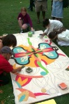Children help with the rangoli at Chorlton Park, by Gowri Savoor